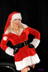 Naughty Santa's helper strips to her alluring ans very sexy red lingerie.