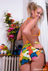 A horny blonde dressed in lots of colours fills her pussy with some seriously