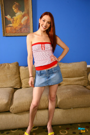 slender redhead plays with