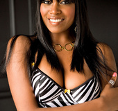 Inviting cute ebony in zebra stripped negligee flaunts sexy curvy shape