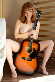 busty musician singing song
