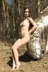 Small-tit brunette demonstrates her naked body in the woods
