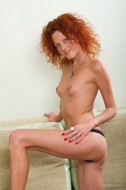 kinky redhead girl undresses