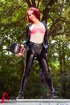 Redhead in black and gold latex outfit shows hot pink bra on skateboard