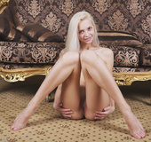 Barely legal slim blonde poses hot in the doggy style
