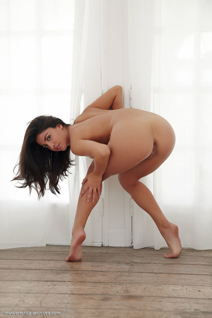 Black-haired young girl is lying naked o - XXX Dessert - Picture 4
