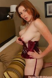 erotic redhead red corset