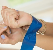 Showy blonde and tape a brunette's hands with blue tape have fun with