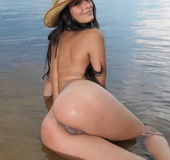 Brunette have a field day on the beach, getting tan, showing pussy!