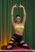 Brunette girl strips her clothes exposing boobs and pussy after yoga session.