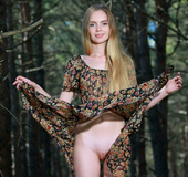 Long-haired blonde teen goes to the woods and shows plump pussy.
