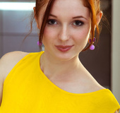 Redhead babe takes her canary dress off kitchen top to expose vag!