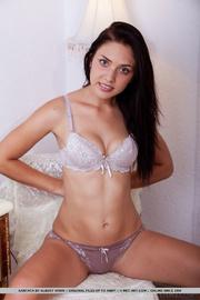 brunette girl sits naked