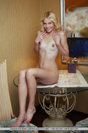 blonde babe sits glass