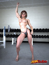 Babe shows off her big muscles and wet pussy in gym!