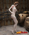Beautiful white brunette girl poses naked in an creepy backroom.
