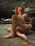 Orange-haired tattooed babe poses on dirty floor of abandoned kitchen.