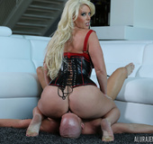 Busty blonde in red and black latex whips bald guy and he licks and fucks