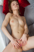 Blond ivory with apple fingers horny pussy on grey couch.