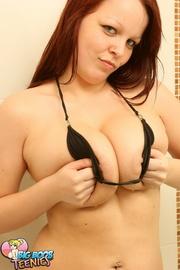 tattooed redhead black bikini