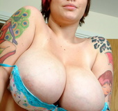 Tasty tattooed chick in blue sweater seduces with big boobs and hot pierced