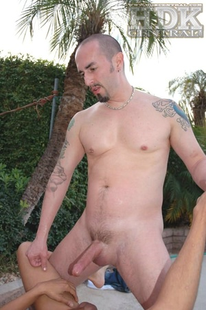 Handsome stud lays down naked on a gray  - XXX Dessert - Picture 2