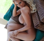 Luscious chick teases with her indulging curves in different poses before