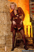 Indulging blonde displays her alluring body in brown dress, black lingerie,