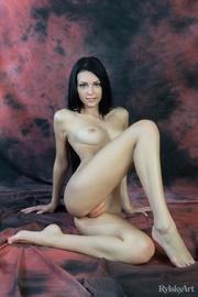 charming brunette bending nude