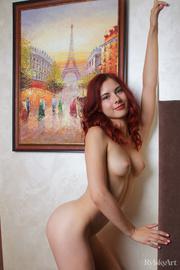 redhead babe hotly poses