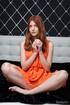 redhead strips orange dress