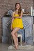brunette yellow dress shyly