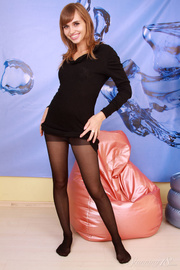 brunette black dressand stockings