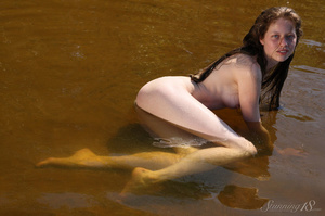 Brunette sexily plays in the shallow wat - XXX Dessert - Picture 9