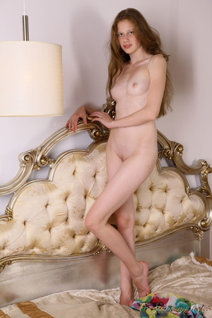 A beautiful slim girl plays on her bed c - XXX Dessert - Picture 3