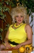 Luscious blonde in yellow dress, yellow and black polka dotted panty,
