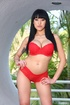Slim brunette cutie in red lingerie shows off big tits, shaved cunt and