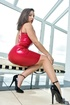 Handsome brunette red leather dress making sure her body is noticed next