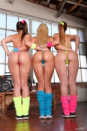three oiled babes dance