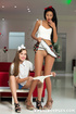 Two young beauties in hairbands strips each others clothes off on red