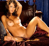 Hypnotic brunette with beautiful smooth skin in ribbon undies in bed showing