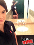 Petite brunette in police uniform and sexy undies undressing by the mirror
