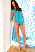 Brunette slut with big brown eyes, wearing fetching blue tank top in white-and-blue