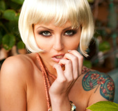 Wicked tattooed blonde by the gate exposing her natural pink breasts to