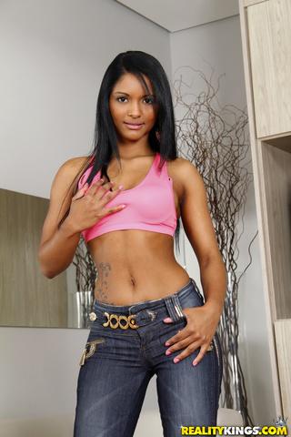 bronze skinned latina stripteasing