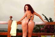 redhead bimbo black bikini