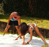Flexible brunette in white booty shorts and top gets her butt hole fucked