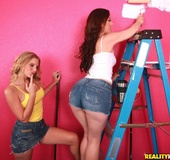 Pretty MILFs work to paint a room pink then shed jean shorts for a sinful