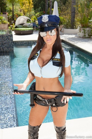 Wonderful brunette in a sexy police offi - XXX Dessert - Picture 1