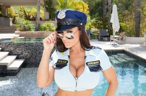 Wonderful brunette in a sexy police offi - XXX Dessert - Picture 2